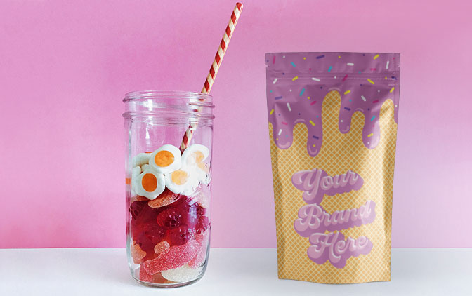 Custom printed stand up pouch, a service offered by The Packaging Lab, next to a jar of sweets.