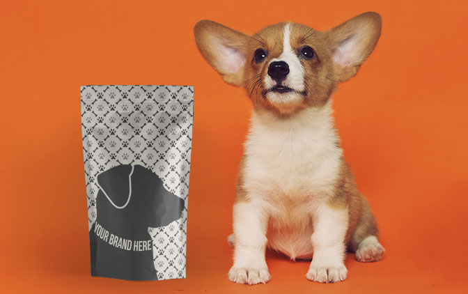 Stand up pouch, custom printed by The Packaging Lab, next to a small dog.