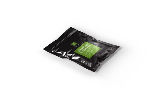 Lay flat black packaging with green square design, printed by The Packaging Lab