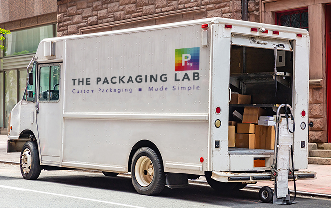 Delivery van with The Packaging Lab's logo on the side, parked on the road