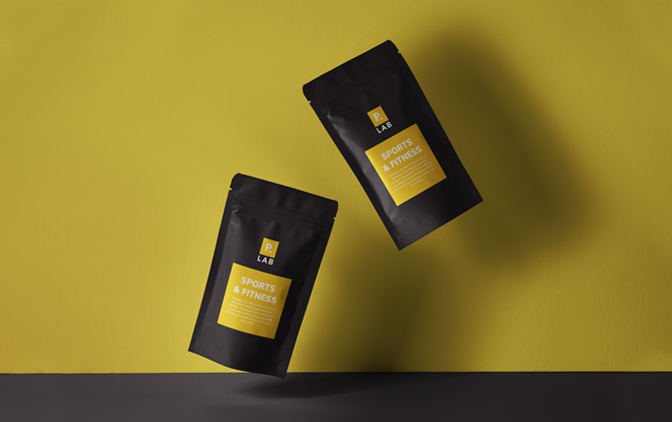 Two custom yellow sports & fitness resealable packages on a yellow background, printed by The Packaging Lab
