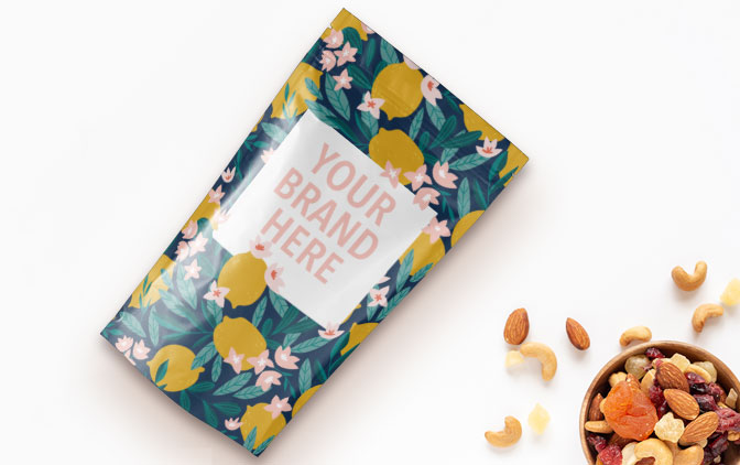 A quality pouch printed by The Packaging Lab next to a bowl of dry seeds and nuts.