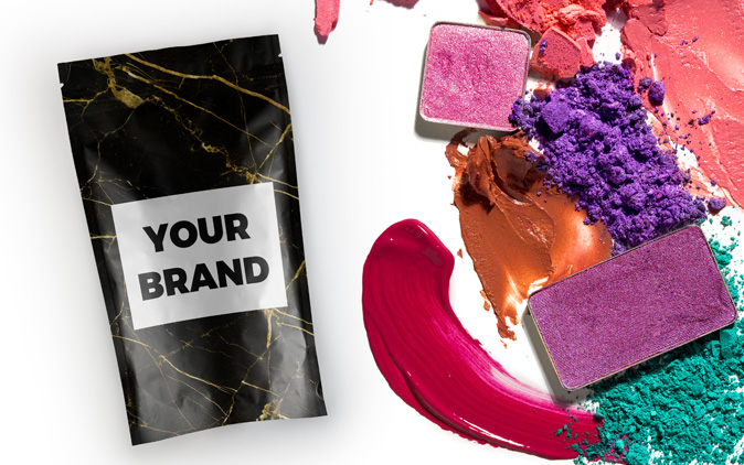 Custom-printed stand up pouch with smears of liquid makeup products. Health and beauty is an industry supported by The Packaging Lab printing services